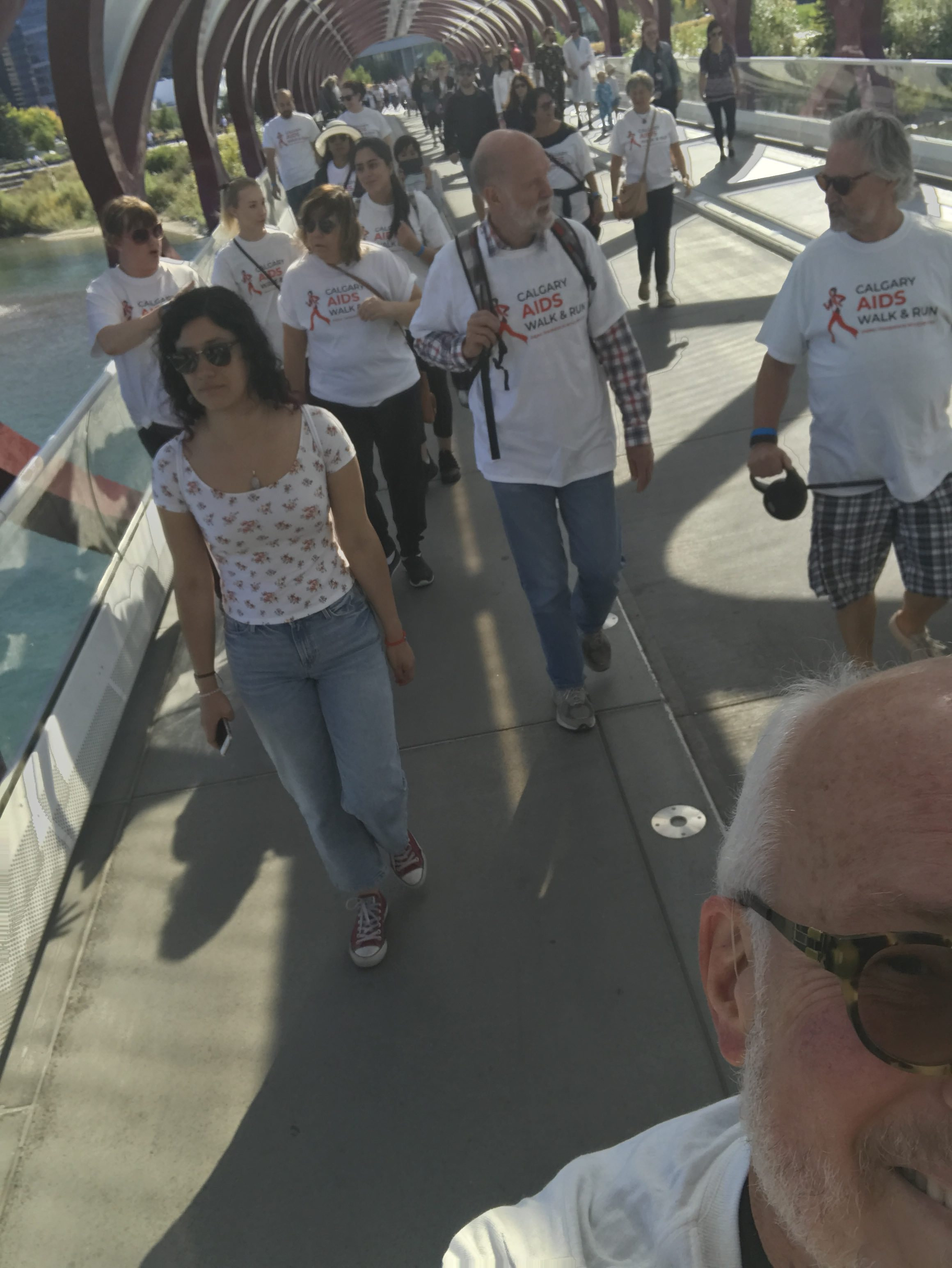 Selfie of Dr. Petty with AIDS Walk & Run participants on the Peace Bridge